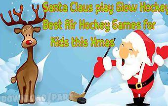 Santa claus play glow hockey - b..