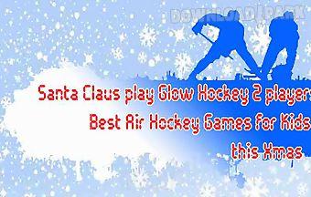 Santa claus play glow hockey 2 p..